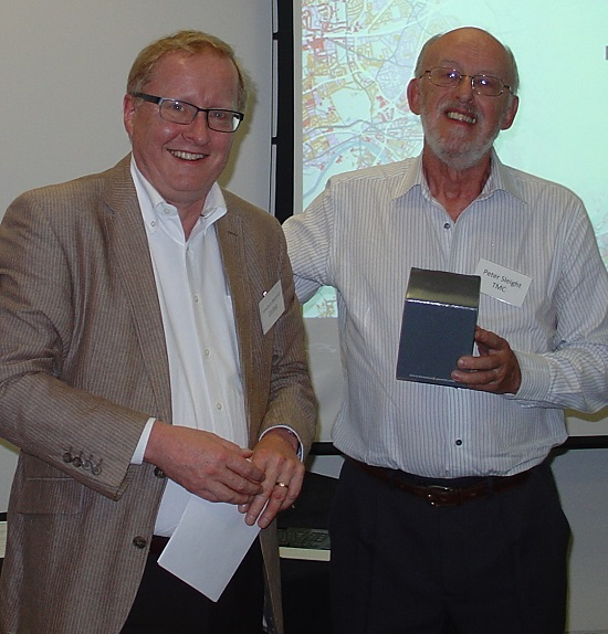 The SLA's Jonathan Reynolds hands over the engraved Tankard to outgoing Chair Peter Sleight