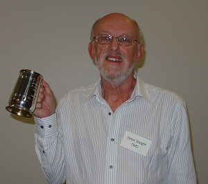 Peter Sleight proudly showing off his long service tankard